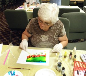Concentrating on an alcohol ink landscape painting